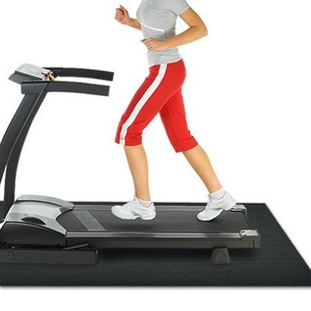 Woman Running On Rubber Cal Treadmill Mat